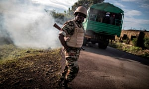 A heavily armed escort sees off a truck carrying polling materials to Buea, in southwestern Cameroon.
