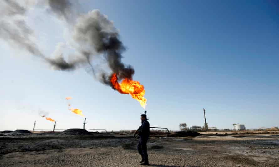 A policeman is seen at West Qurna-1 oil field, which is operated by ExxonMobil, in Basra, Iraq.