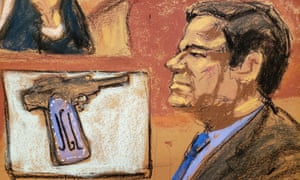 """Joaquin """"El Chapo"""" Guzman is seen with a handgun on display during a testimony by the DEA"""