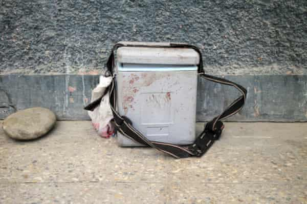 A bloodied polio vaccine box, discarded after female vaccinators were killed by gunmen in the city of Jalalabad, Afghanistan on 30 March