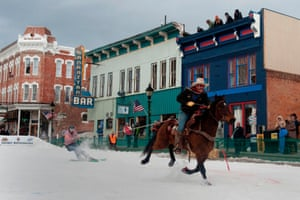 Leadville, US. Rider Jeff Dahl races down Harrison Avenue towing his son Jason on skis during the 68th annual skijoring competition in Colorado. The city, with an elevation of 3,094 metres, has been hosting the Scandinavian sport since 1949