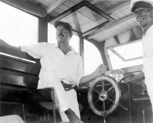 Hemingway at the wheel of his boat, Pilar, with Carlos Gutierrez in 1934