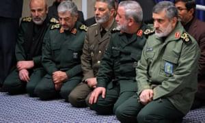 Gen Amir Ali Hajizadeh, right, attends a mourning ceremony for Gen Qassem Suleimani
