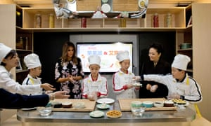 Melania Trump takes part in a cooking clbad at Banchang primary school in Beijing.