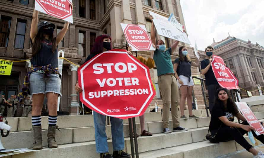 Voting rights activists protest new voting restrictions in Austin, Texas.