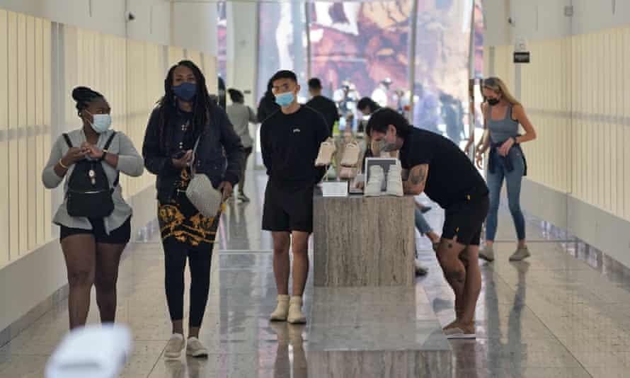 people wear masks in a shoe store in LA
