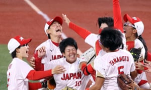 Japan celebrates after defeating the United States 2-0 in the softball gold medal game.