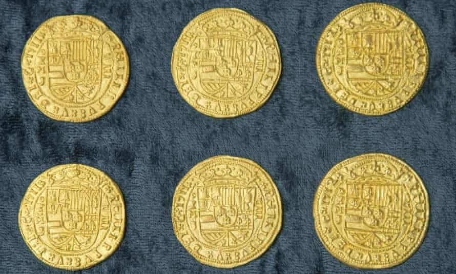 Six royal gold coins recovered from a Spanish shipwreck near Florida.