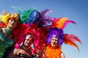 Parade goers in carnival dress