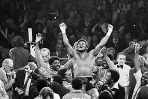 Leon Spinks is raised on shoulders in triumph at the Las Vegas Hilton Pavilion after winning the world heavyweight title in split decision – and a huge upset – against Muhammad Ali.