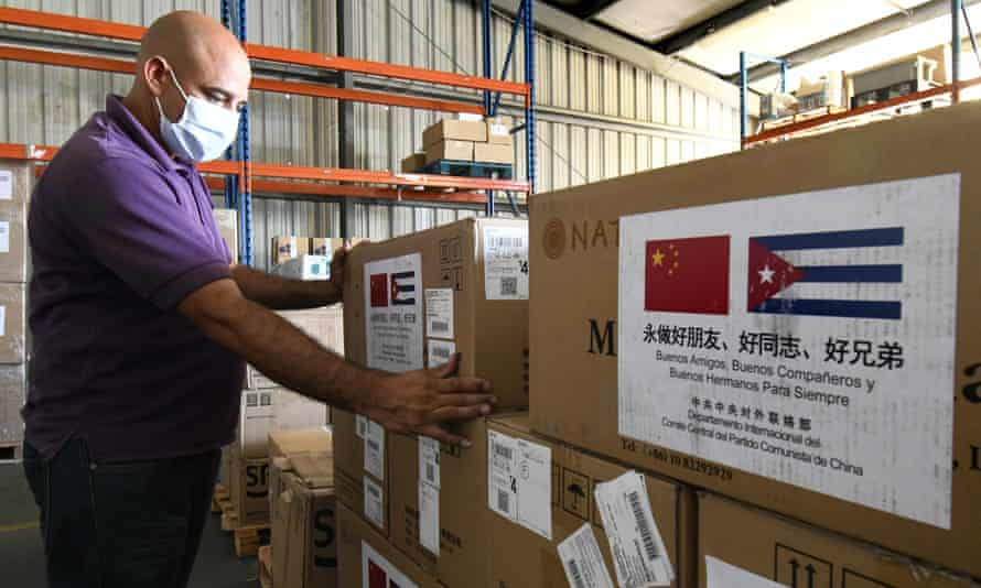 A worker transports medical supplies donated to Cuba from China.