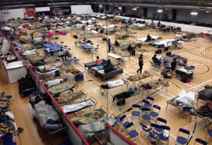 Canadian wildfires: camp beds are set up on the gym floor at an evacuee reception centre in Wood Buffalo