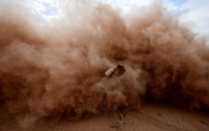A photographer is engulfed by dust
