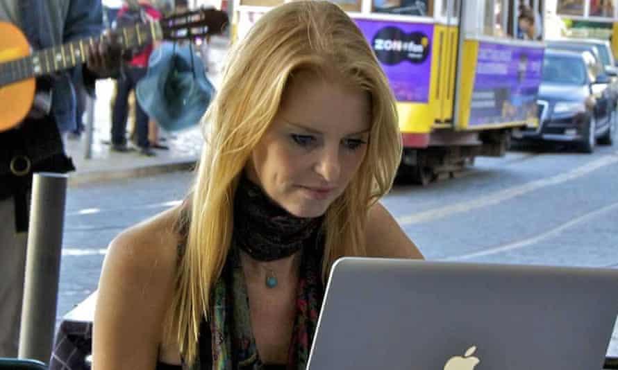 Helen Barlow sitting at laptop