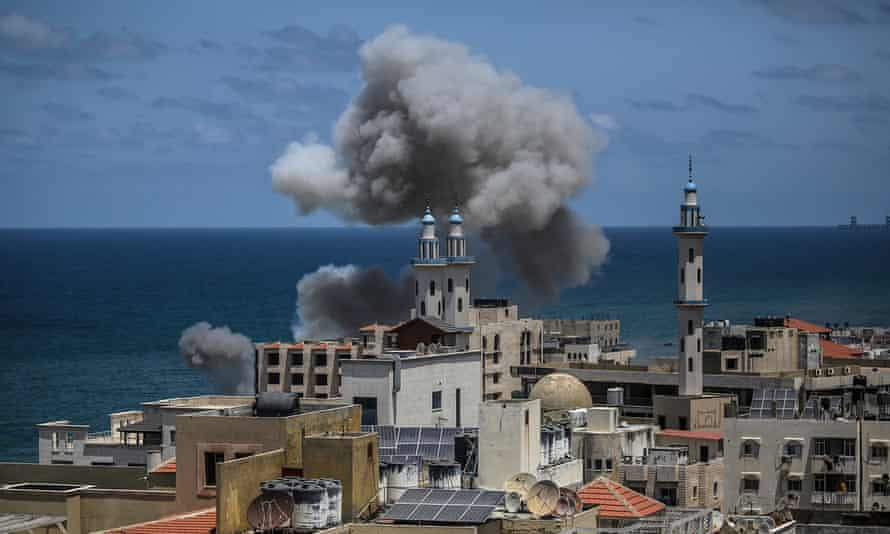 Smoke rises over a mosque in Gaza City after an Israeli airstrike