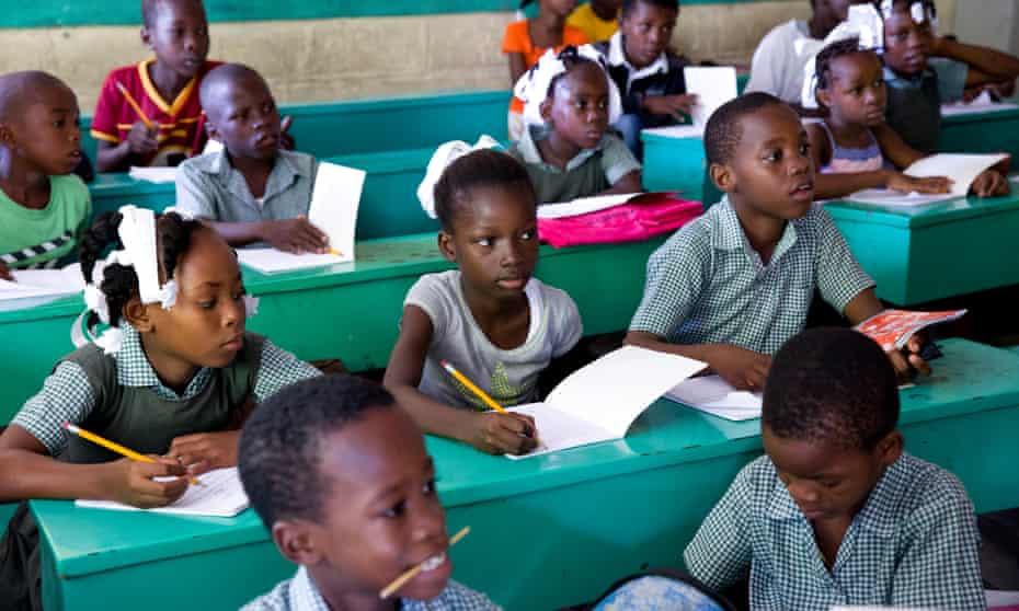 Children attend school in Cité Soleil, in the Haitian capital Port-au-Prince