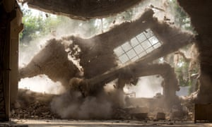 The walls of Chinese artist Ai Weiwei's studio collapse during demolition.