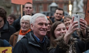 John McDonnell, the shadow chancellor, joins Picturehouse cinema workers at a protest in Leicester Square, central London.