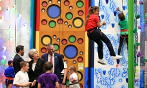 Lancashire, EnglandPrime Minister Theresa May watches a girl as she descends a climbing wall during a visit to the Leisure Box while on the local elections campaign trail.