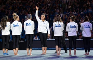 UCLA Bruins' Kyla Ross waves towards the crowd before an NCAA college gymnastics meet against Arizona State in Los Angeles during January 2019.