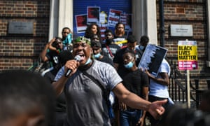 Protesters outside tottenham police station in north london