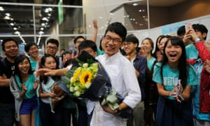 Nathan Law celebrates after winning a seat in the Legislative Council election.