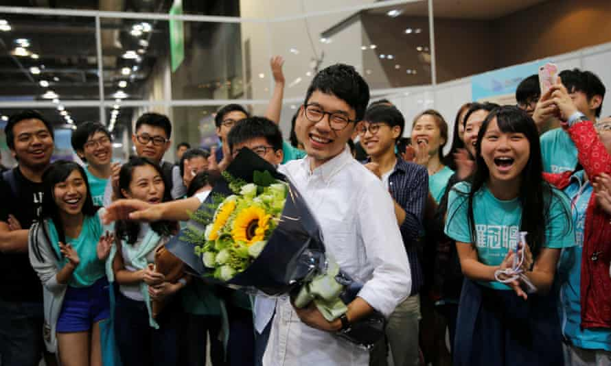 Nathan Law celebrates alongside Joshua Wong after winning a seat in the legislative council election in Hong Kong in September.