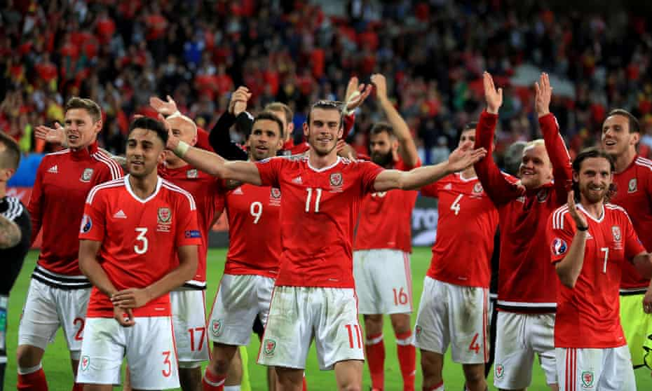 Gareth Bale leads the celebrations after the quarter-final win over Belgium.