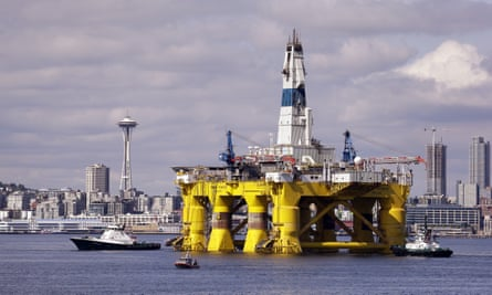 The oil drilling rig Polar Pioneer is towed toward a dock in Elliott Bay in Seattle. The rig is the first of two drilling rigs Royal Dutch Shell is outfitting for Arctic oil exploration.