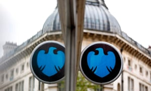 A Barclays' sign mirrored in a window