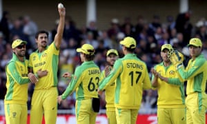 Australia's Mitchell Starc, second left, holds up the ball to celebrate the dismissal of West Indies' Sheldon Cottrell.