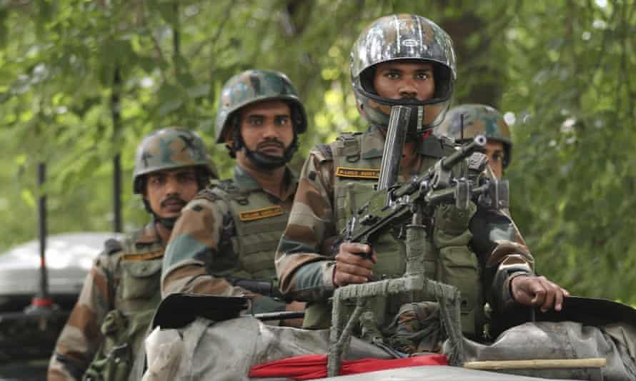 Indian army soldiers guard a war memorial in Srinagar