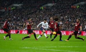 Son Heung-Min of Tottenham Hotspur scores the second goal whilst being marked by five Bournemouth players.