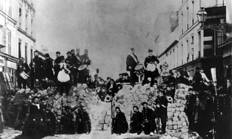 Communards and supporters at a barricade in the rue de Charonne, Paris.