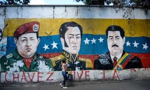 A mural of Chávez, Bolívar and Maduro in Caracas.