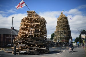 Belfast, UKLoyalists finish a bonfire in East Belfast in preparation for the 11th night celebrations in Belfast, Northern Ireland. Tradition holds that the bonfires commemorate the lighting of fires on the hills to help Williamite ships navigate through Belfast Lough at night when Protestant King William III and his forces landed at Carrickfergus to fight the Catholic Jacobites