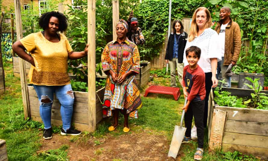 Volunteers with community gardener Fabrice (middle) who formed group to supply elderly and vulnerable families with food and plants during lockdown.