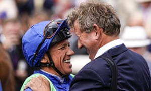 Mark Johnston with Frankie Dettori last year, after the Italian jockey rode him his 4,194th winner, breaking the record for a trainer in Britain.