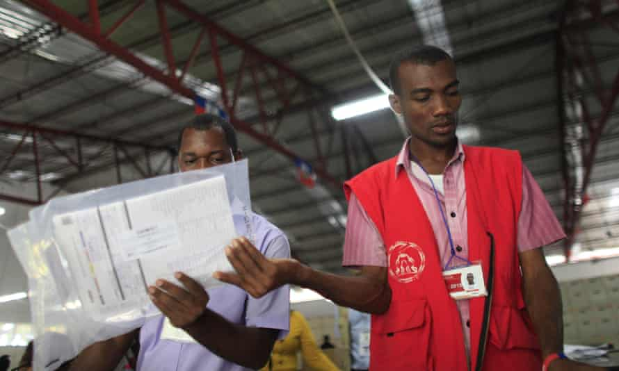 Electoral workers sort ballots at a tabulation center in Port-au-Prince, Haiti, on Monday.