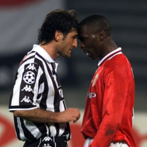 Manchester United's Andy Cole goes head to head during an argument with Juventus's Ciro Ferrara .