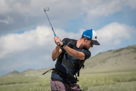 Adam Rolston opts for an iron from the rough.