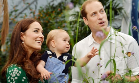 The Duke and Duchess of Cambridge with Prince George looking up (at butterflies you can't see) and smiling