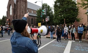 """Protesters called for change and chalked """"Wake up, Mitch"""" in front of US Senate majority leader and Kentucky Republican Mitch McConnell's residence in Washington yesterday."""