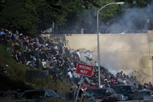 Protesters race up a hill after police fired teargas during a demonstration in Philadelphia.