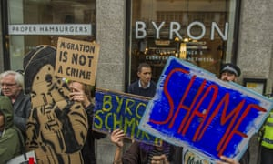 Protesters at a branch of the Byron burger chain