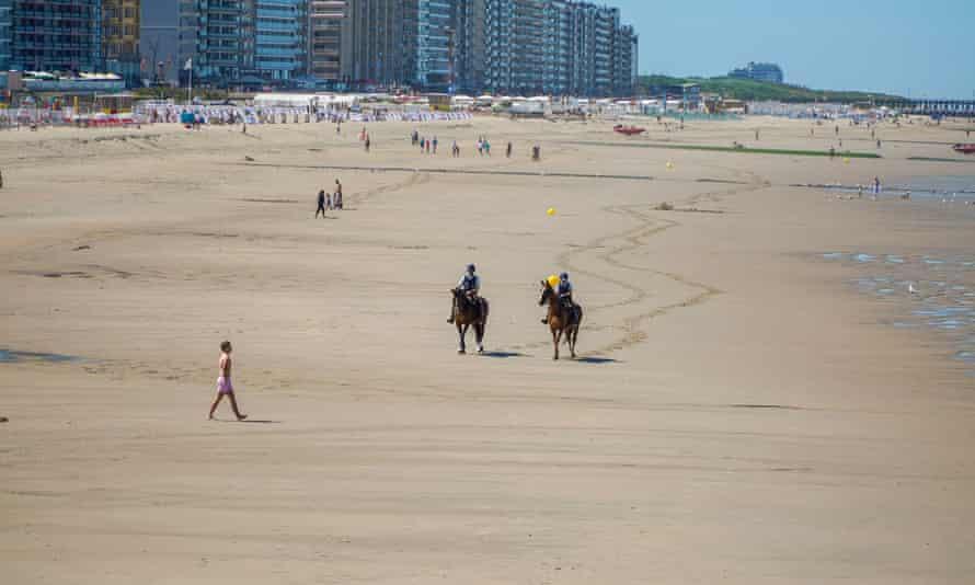 Police on horseback patrol the beach at Blankenberge, Belgium.