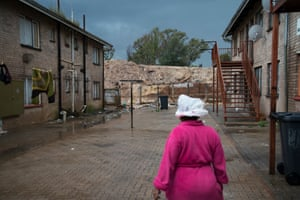 Patricia Hendricks walks into her yard in Mitchell's Park in Davidsonville with a plastic bag on her head to protect her from the rain. <br><br>When it rains, the rainwater running off the mine dump and into the yard becomes filled with toxics. 'It's called ghost town,' she says, because of the cemetery, which borders the complex on one side. Others say it's called ghost town because of the many people who have died here from mine-dump related illnesses