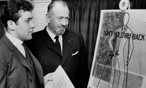 In this 22 March 1963, file photo, John Steinbeck, right, admires a prize-winning poster by his son Thomas Steinbeck in Hartford, Connecticut.