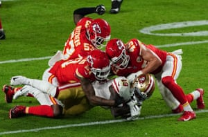 Deebo Samuel, wide receiver of the San Francisco 49ers, is tacked by Bashaud Breeland, cornerback of the Kansas City Chiefs and Daniel Sorensen, safety.