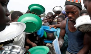 Internally displaced people wait for food to be distributed at a camp in Bunia, Ituri province, eastern DRC